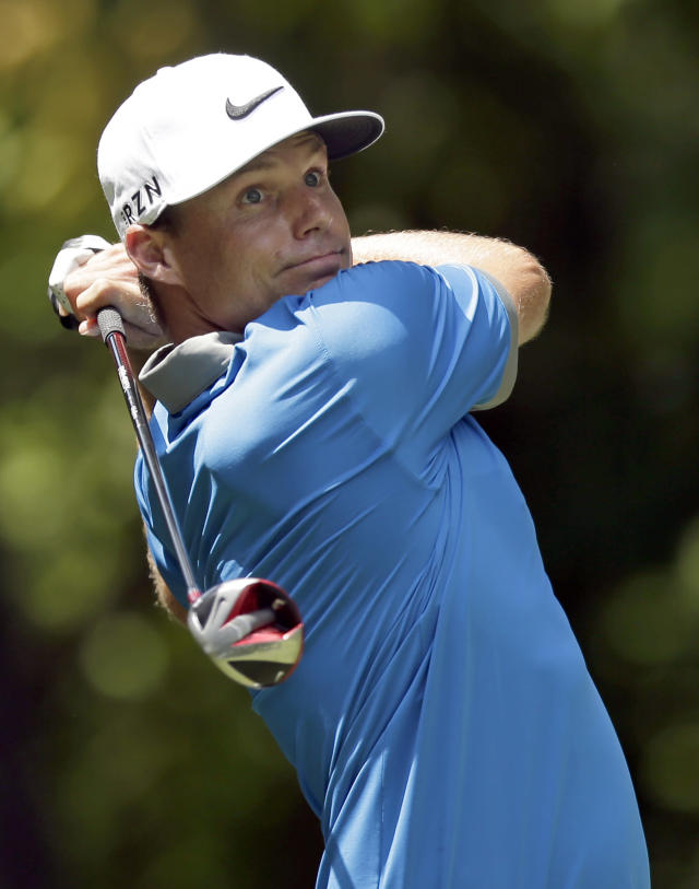 Nick Watney watches his tee shot on the second hole during the third round of the Wyndham Championship golf tournament in Greensboro, N.C., Saturday, Aug. 16, 2014. (AP Photo/Chuck Burton)