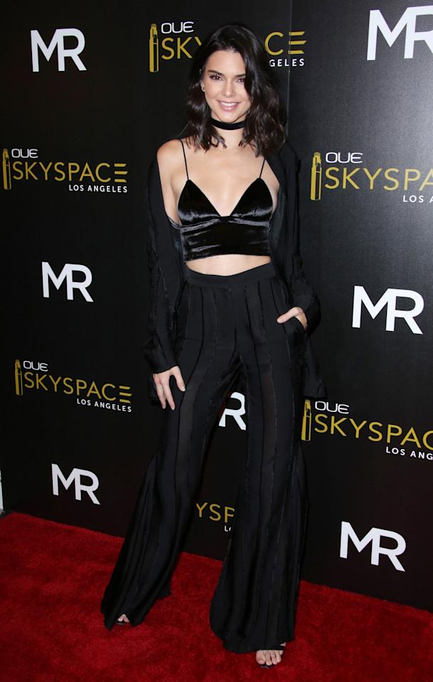 <p>Kendall does love her crop tops, as she proved at a launch this summer. Who can blame her, with abs like that? [Photo: Rex] </p>