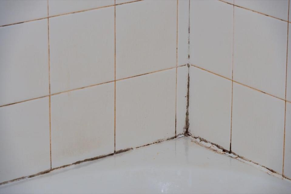 """However, before you go to re-caulk that tub, it's essential that you remove any existing caulk first. """"This is a big issue because mold still grows over the top layer and it does not seal it properly, creating potential for leaks,"""" explains Maher."""