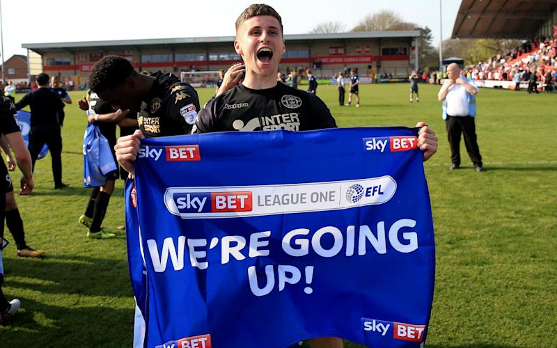 Wigan Athletic have sealed promotion to the Championship - PA