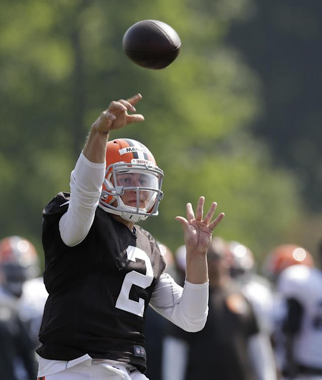 Cleveland Browns quarterback Johnny Manziel passes during practice at the NFL football team's training camp Monday, Aug. 4, 2014, in Berea, Ohio. (AP Photo/Tony Dejak)