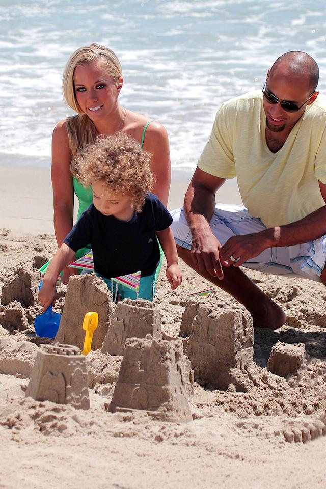 """There's nothing like making a sand castle with mom and dad! Gaz Shirley/Kevin Perkins/<a href=""""http://www.PacificCoastNews.com"""" target=""""new"""">PacificCoastNews.com</a> - July 19, 2011"""
