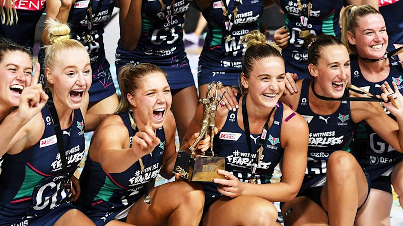 The Vixens are celebrate with the trophy after winning the 2020 Super Netball Grand Final.