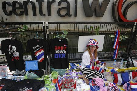 A vendor sells accessories to anti-government protesters at one of their encampment in Bangkok's shopping district March 1, 2014. REUTERS/Damir Sagolj