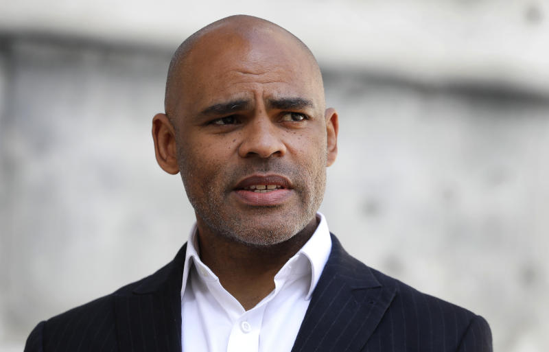 The Mayor of Bristol, Marvin Rees speaks to the Associated Press in Bristol, England, Monday, June 8, 2020, following the downing of a statue of Edward Colston on Sunday at a Black Lives Matter demo. The toppling of the statue was greeted with joyous scenes, recognition of the fact that he was a notorious slave trader — a badge of shame in what is one of Britain's most liberal cities. (AP Photo/Kirsty Wigglesworth)