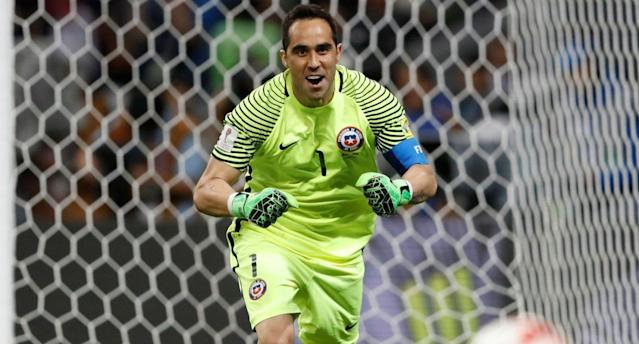 "<a class=""link rapid-noclick-resp"" href=""/soccer/players/claudio-bravo/"" data-ylk=""slk:Claudio Bravo"">Claudio Bravo</a> saved all three Portugal penalties to help Chile reach the Confederations Cup final. (Reuters)"