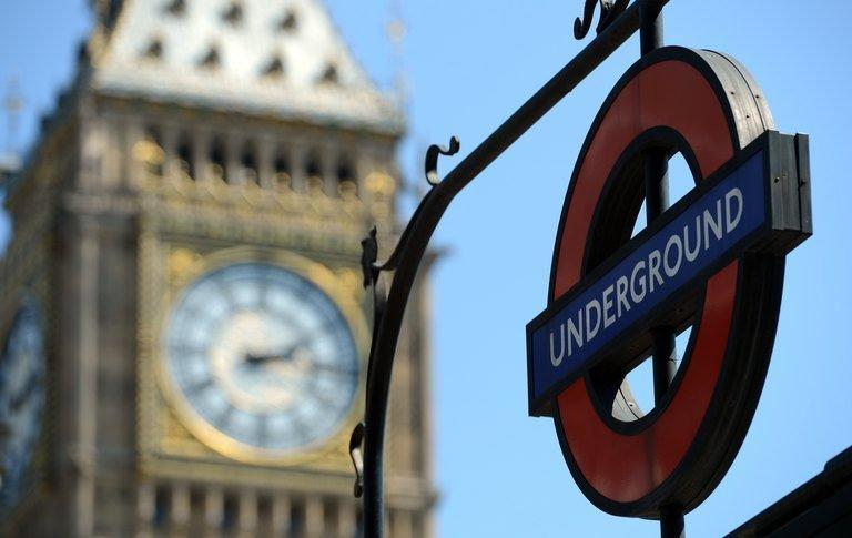 "An underground sign is pictured next to the ""Big Ben"" clock tower on July 24, 2012. The London Underground began celebrating its 150th birthday on Wednesday, creaking under the demand of four million daily passengers as it looked back to the opening of the world's first underground railway in 1863"