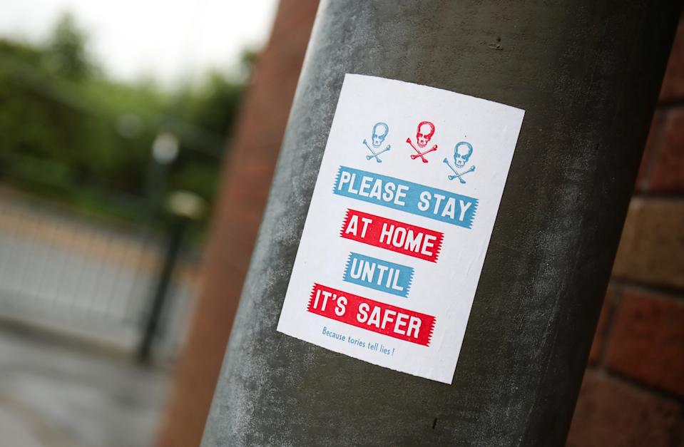 A view shows a sign advising people to stay home, amid the outbreak of the coronavirus disease (COVID-19), in Oldham, Britain, August 19, 2020. REUTERS/Molly Darlington