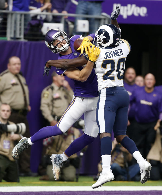 <p>Los Angeles Rams free safety Lamarcus Joyner (20) breaks up a pass intended for Minnesota Vikings wide receiver Adam Thielen during the first half of an NFL football game, Sunday, Nov. 19, 2017, in Minneapolis. (AP Photo/Bruce Kluckhohn) </p>