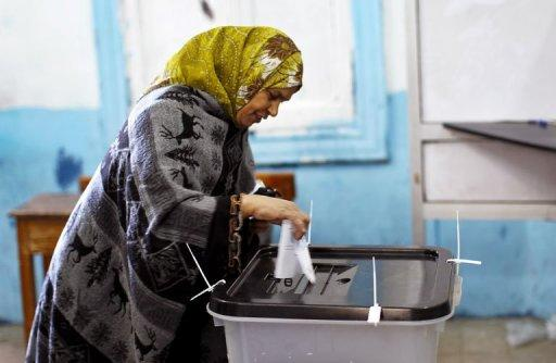 A woman casts her ballot at a polling station in Giza, south of Cairo, on December 22, 2012