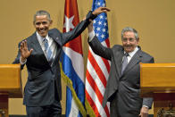 FILE - In this March 21, 2016, file photo, Cuban President Raul Castro, right, lifts up the arm of President Barack Obama at the conclusion of their joint news conference at the Palace of the Revolution in Havana, Cuba. Obama's handling of the Syrian civil war was widely perceived as a major foreign policy failure. That stood alongside substantial foreign policy wins, including the Iran nuclear deal, which infuriated traditional U.S. allies Israel and Saudi Arabia, and normalization of relations with Cuba, both of which Trump made a priority to rip apart. (AP Photo/Ramon Espinosa, File)
