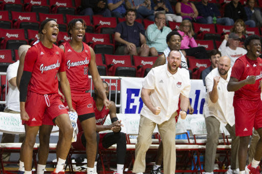 The Jacksonville State bench erupts after a 3-point shot in the second half of an NCAA college basketball game against Chicago State at the Emerald Coast Classic in Niceville, Fla., Friday, Nov. 29, 2019. (AP Photo/Mark Wallheiser)