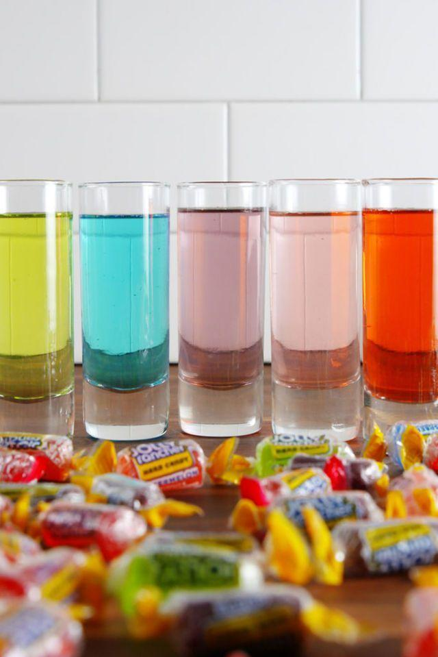 "<p>Take trick-or-treating to a while new level with these rainbow Jolly Rancher shots. All you need is vodka, seltzer, and plenty of these cheerful hard candies. </p><p>Get the recipe from <a href=""https://www.delish.com/cooking/recipe-ideas/recipes/a52051/jolly-ranchers-shots-recipe/"" target=""_blank"">Delish</a>. </p>"