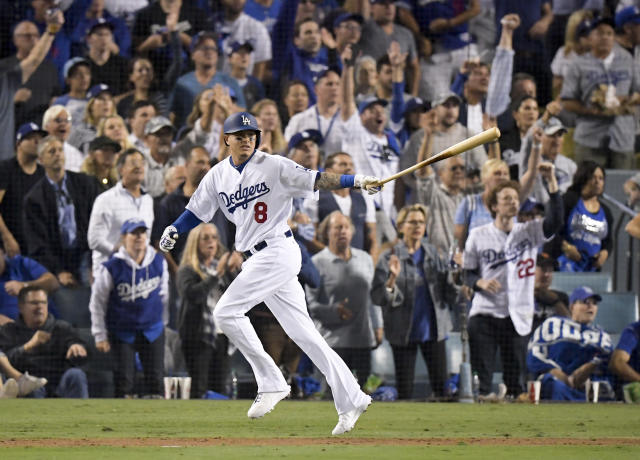 FILE - In this Oct. 26, 2018, file photo, Los Angeles Dodgers' Manny Machado watches his single against the Boston Red Sox during the sixth inning in Game 3 of the baseball World Series in Los Angeles. Andrew Friedman knew he was getting a player who didn't hustle all the time when he traded for Machado. Still, the Dodgers' president of baseball operations was willing to acquire the four-time All-Star infielder because his good points outweighed the bad. (AP Photo/Mark J. Terrill, File)