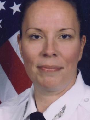 Life goes on: These days Lisa works as a sheriff's deputy.