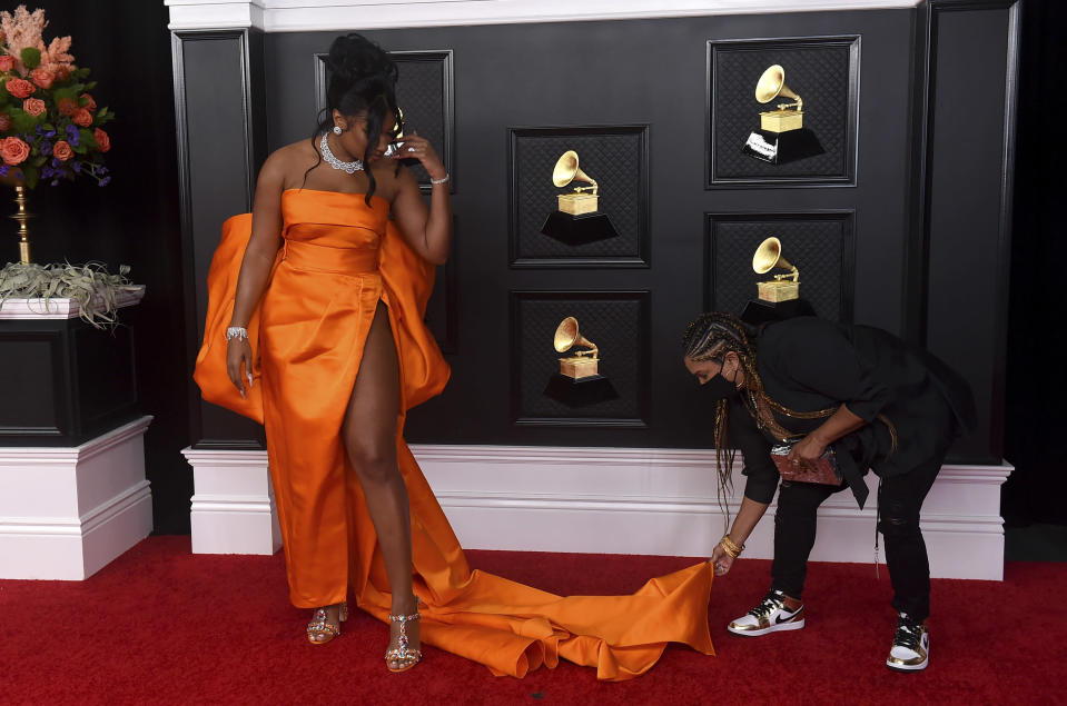Megan Thee Stallion arrives at the 63rd annual Grammy Awards at the Los Angeles Convention Center on Sunday, March 14, 2021. (Photo by Jordan Strauss/Invision/AP)