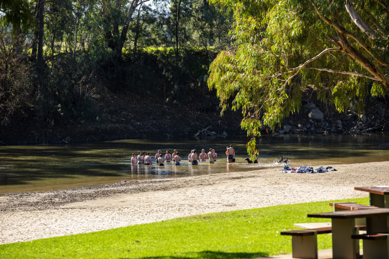 WAGGA WAGGA, AUSTRALIA - MAY 05: A group of men congregate in the waters of Wagga Beach on the Murrumbidgee River on May 05, 2019 in Wagga Wagga, Australia. Wagga Wagga is a major regional city in the Riverina region of New South Wales, with a population of more than 54,000 at the 2016 census. Wagga Wagga is the state's largest inland city and is an important agricultural, military, and transport hub of Australia. (Photo by Jenny Evans/Getty Images)
