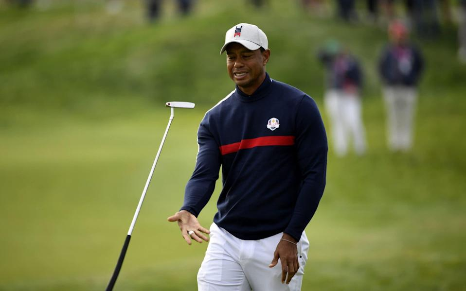 US golfer Tiger Woods juggles his putter during his fourball match on the first day of the 42nd Ryder Cup at Le Golf National Course - AFP