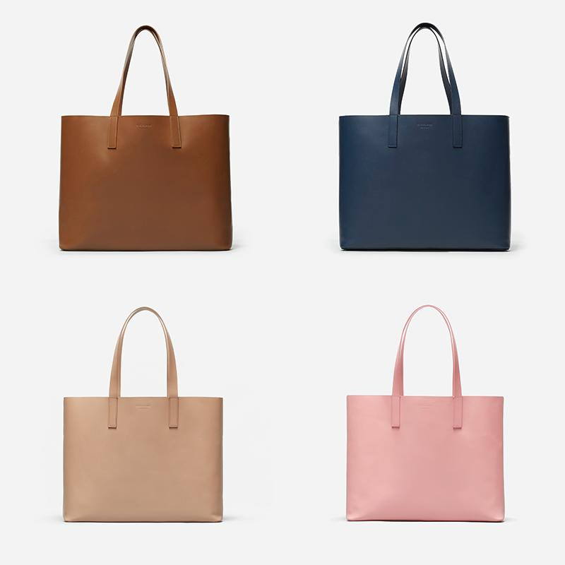 Clockwise from top left: Everlane Day Market Tote in Cognac, Navy, Light Taupe and Rose. (Photo: Everlane)