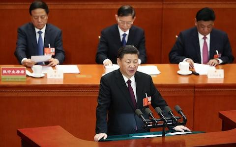 Chinese President Xi Jinping delivers a speech during the closing session of the National People's Congress (NPC) at the Great Hall of the People on March 20 - Credit: Lintao Zhang/Getty Images