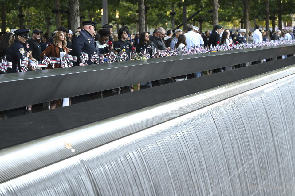 People visit the National September 11 Memorial in New York on the 20th anniversary of the attacks, Saturday, Sept. 11, 2021. .(David Handschuh/Pool Photo via AP)