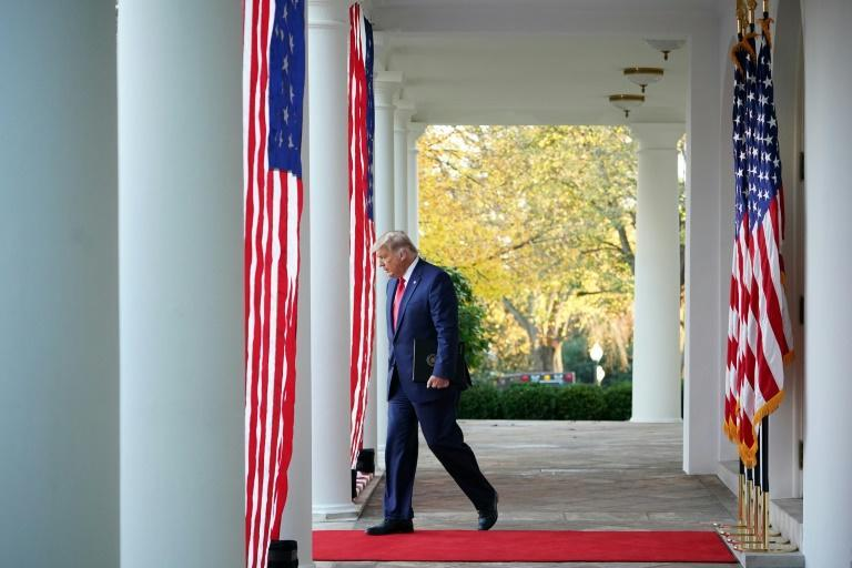 US President Donald Trump arrives to deliver an update on Covid-19 vaccines in the Rose Garden of the White House in Washington, DC on November 13