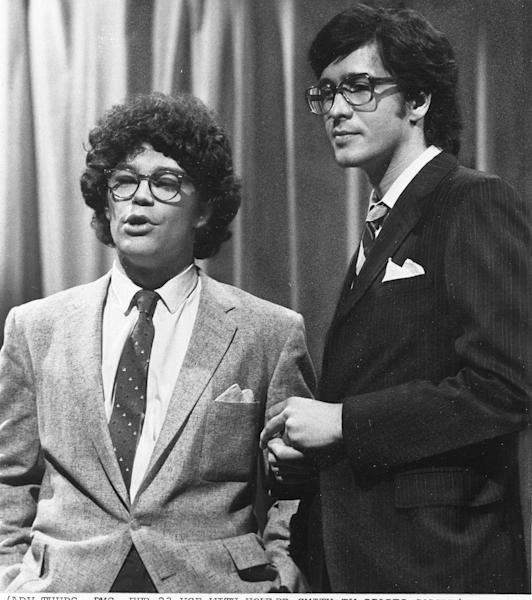 """HOLD FOR OBIT STORY - FILE - This 1978 file photo from NBC shows """"Saturday Night Live"""" writer/performers Al Franken, left, and Tom Davis in New York. Davis, a writer and performer who with Franken developed some of the most popular skits in the early years of """"Saturday Night Live,"""" died Thursday, July 19, 2012. He was 59. (AP Photo/NBC-TV, File)"""