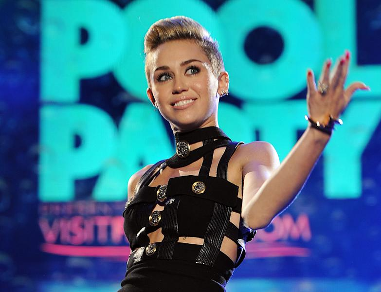 """FILE - This June 29, 2013 file photo shows Miley Cyrus hosting the iHeartRadio Ultimate Pool Party at the Fontainebleau Hotel in Miami. Cyrus' song, """"We Can't Stop,"""" is one of the top songs of the summer. (Photo by Jeff Daly/Invision/AP, File)"""