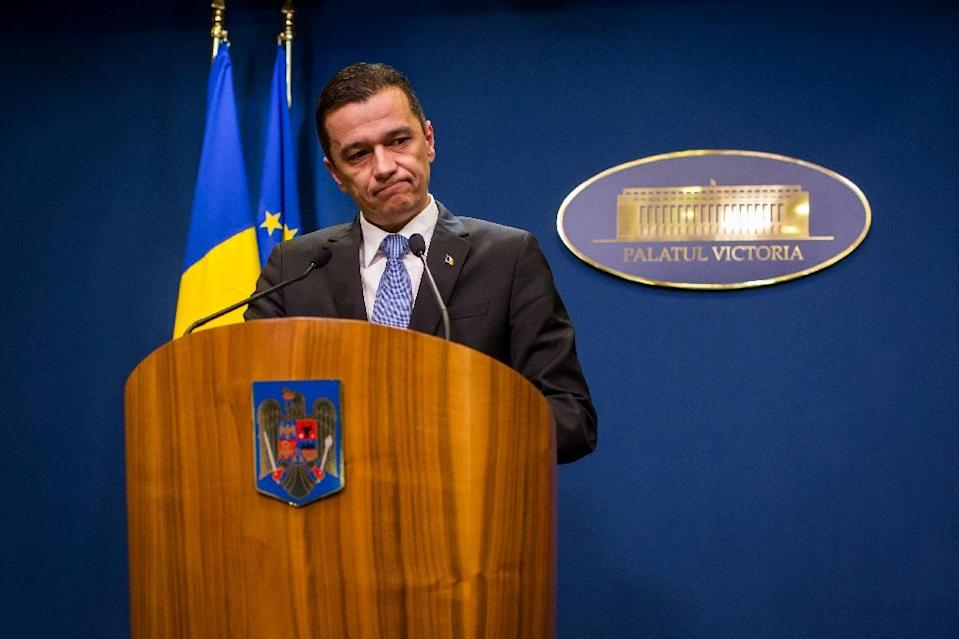 Romanian Prime Minister Sorin Grandeanu has vowed to stay on despite the protests (AFP Photo/ANDREI PUNGOVSCHI)