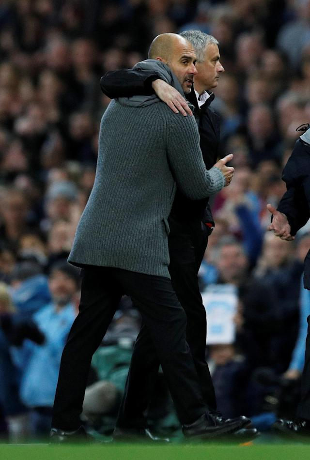"""Soccer Football - Premier League - Manchester City v Manchester United - Etihad Stadium, Manchester, Britain - November 11, 2018 Manchester City manager Pep Guardiola with Manchester United manager Jose Mourinho after the match REUTERS/Darren Staples EDITORIAL USE ONLY. No use with unauthorized audio, video, data, fixture lists, club/league logos or """"live"""" services. Online in-match use limited to 75 images, no video emulation. No use in betting, games or single club/league/player publications. Please contact your account representative for further details."""