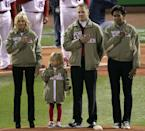 ST LOUIS, MO - OCTOBER 19: (L-R) Dr. Jill Biden, army veteran Red Schoendienst and first lady Michelle Obama stand on the mound prior to the start of Game One of the MLB World Series between the Texas Rangers and the St. Louis Cardinals at Busch Stadium on October 19, 2011 in St Louis, Missouri. (Photo by Jamie Squire/Getty Images)