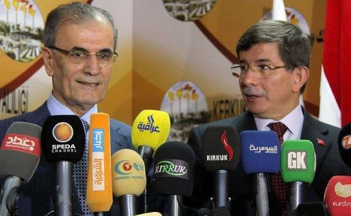 Davutoglu (right) made the side-trip to Kirkuk while on a visit to Iraqi Kurdistan