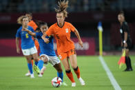Netherlands' Jill Roord controls the ball against Brazil's Debinha during a women's soccer match at the 2020 Summer Olympics, Saturday, July 24, 2021, in Miyagi, Japan. (AP Photo/Andre Penner)
