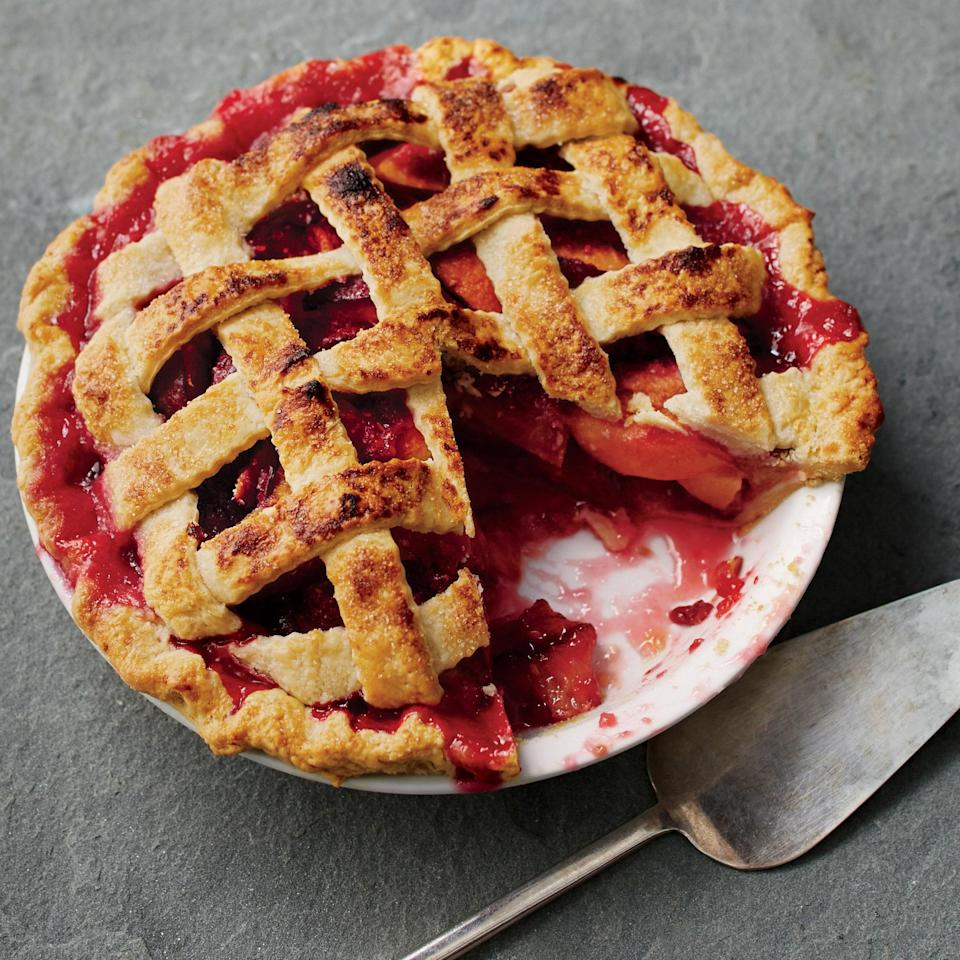 "Crisp lattice crust, sweet and tart filling of nectarines, plums, and raspberries—this classic pie makes use of some of the juiciest summer fruits. <a href=""https://www.epicurious.com/recipes/food/views/nectarine-plum-and-raspberry-pie-51238250?mbid=synd_yahoo_rss"" rel=""nofollow noopener"" target=""_blank"" data-ylk=""slk:See recipe."" class=""link rapid-noclick-resp"">See recipe.</a>"