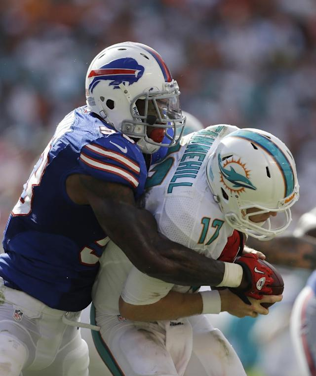 Buffalo Bills outside linebacker Nigel Bradham (53) sacks Miami Dolphins quarterback Ryan Tannehill (17) during the second half of an NFL football game, Sunday, Oct. 20, 2013, in Miami Gardens, Fla. (AP Photo/Lynne Sladky)