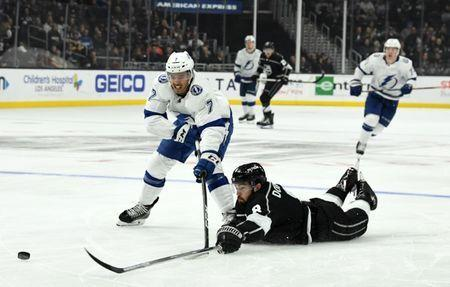 Jan 3, 2019; Los Angeles, CA, USA; Tampa Bay Lightning right wing Mathieu Joseph (7) and Los Angeles Kings defenseman Drew Doughty (8) battle for the puck in the third period at Staples Center.The Lightning defeated the Kings 6-2 .Mandatory Credit: Kirby Lee-USA TODAY Sports