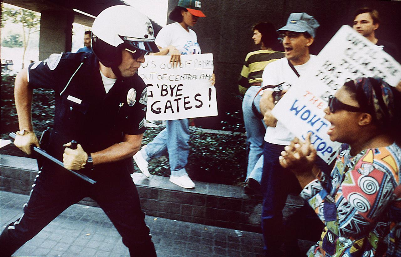 <p>A police officer uses his baton on a protester at the corner of First St. and Broadway, April 29, 1992, in Los Angeles, after the acquittal of four Los Angeles Police officers for the videotaped beating of Rodney King. (Photo: Kirk McKoy/Los Angeles Times via Getty Images) </p>
