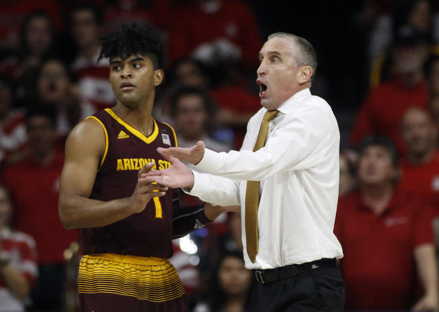 Arizona State guard Remy Martin (1) attempts to settle down head coach Bobby Hurley as he reacts to a call during the second half of a loss to Arizona. (AP)