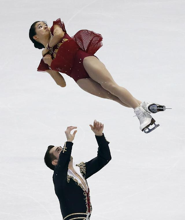 DeeDee Leng and Timothy LeDuc compete during the pairs free skate at the U.S. Figure Skating Championships in Boston, Saturday, Jan. 11, 2014. (AP Photo/Elise Amendola)