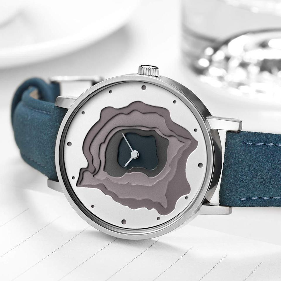 """<h3><strong>Leather-Banded Geode Watch</strong></h3><br>This unique accessory features a hollowed-out and geode-layered face that's complimented by a sturdy yet soft leather band.<br><br><strong>Rating:</strong> 4.3 out of 5 stars, and 30 reviews<br><br><strong>A Satisfied Customer Review: </strong>""""I don't know if I can really express how much I love this watch. I'm not a person who wears watches but decided to give it a try. The band is wayyyyyy nicer than I expected for a watch at this price. Its stiffer underneath but feels like micro fiber on top of the strap. Has been keeping time accurately since I set it. And I love the overall look. I'll def buy in other colors.""""<br><br><strong>STARKLING</strong> Hollow Quartz Watch With Leather Band, $, available at <a href=""""https://www.amazon.com/STARKING-Leather-Japanese-Minimalist-Waterproof/dp/B074L16746"""" rel=""""nofollow noopener"""" target=""""_blank"""" data-ylk=""""slk:Amazon"""" class=""""link rapid-noclick-resp"""">Amazon</a>"""