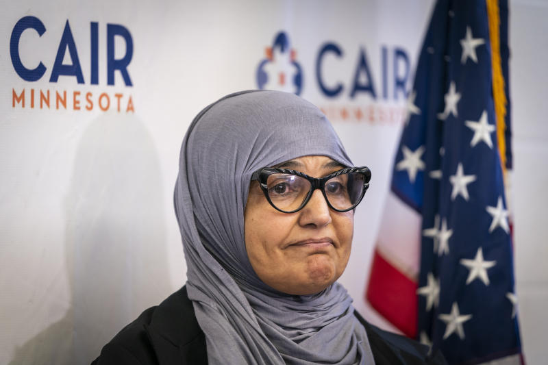 Aida Shyef Al-Kadi, of St. Louis Park, attends a press conference at CAIR-MN headquarters in Minneapolis on Tuesday, December 17, 2019. Al-Kadi reached a settlement with Ramsey County for $120,000 after claiming religious discrimination after being forced to remove her hijab for a booking photo and go without a hijab for a time while in jail. (Leila Navidi/Star Tribune via AP)