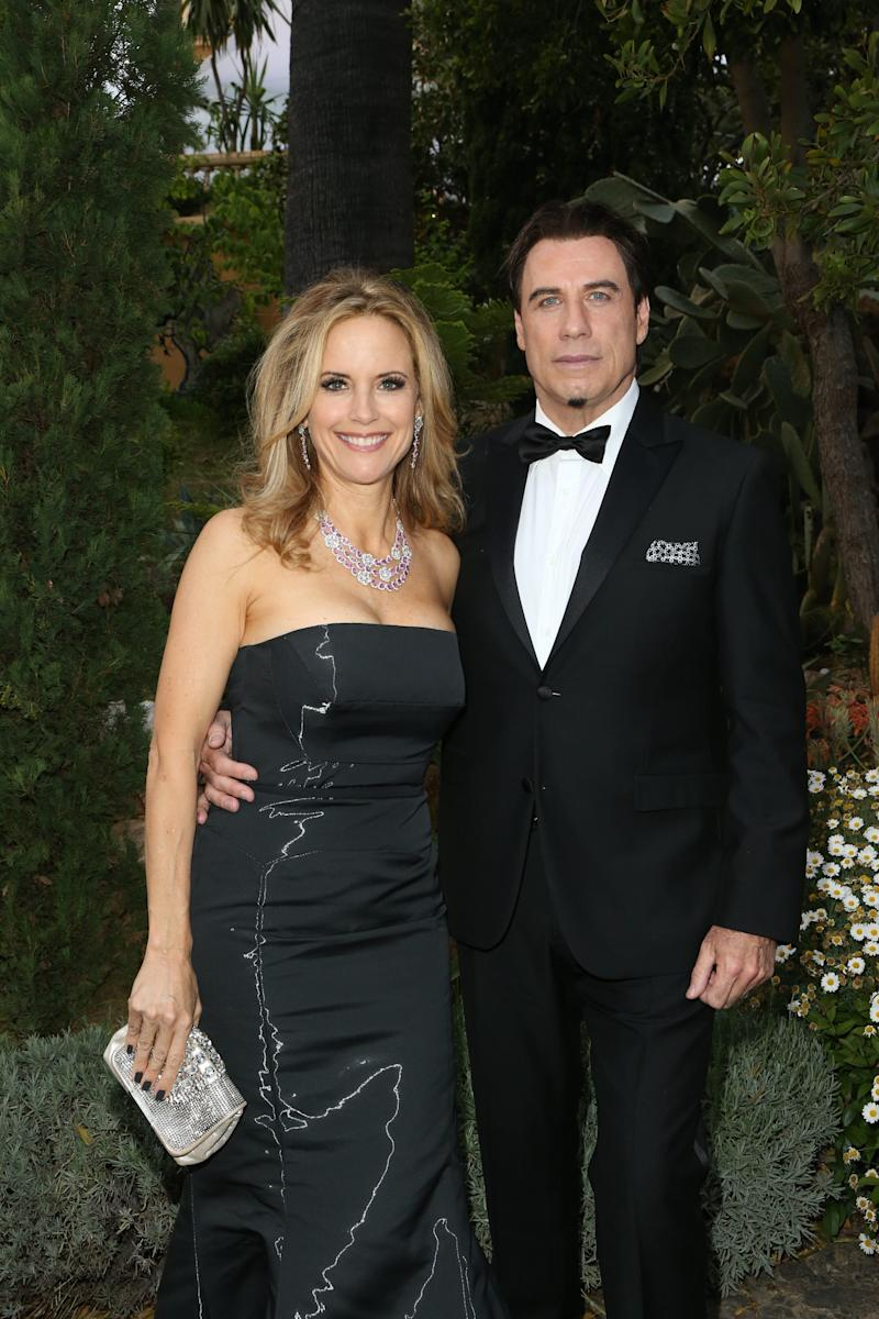 CANNES, FRANCE - MAY 21: Kelly Preston and John Travolta attend the Puerto Azul Experience: Inside Party at the 67th Annual Cannes Film Festival on May 21, 2014 in Cannes, France. (Photo by Michel Dufour/French Select/Getty Images) (Photo: Michel Dufour via Getty Images)