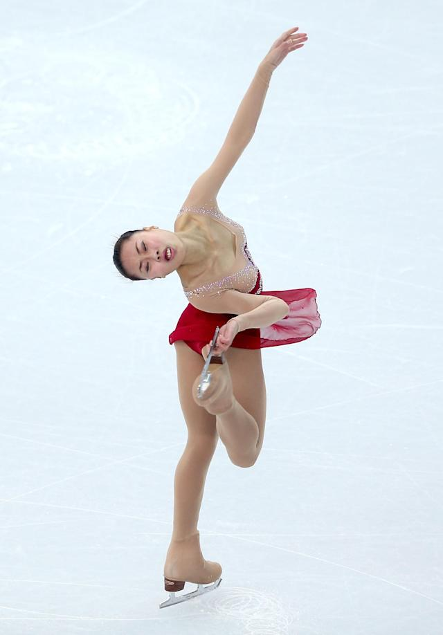 SOCHI, RUSSIA - FEBRUARY 08: Kexin Zhang of China competes in the Figure Skating Team Ladies Short Program during day one of the Sochi 2014 Winter Olympics at Iceberg Skating Palace on February 8, 2014 in Sochi, Russia. (Photo by Matthew Stockman/Getty Images)