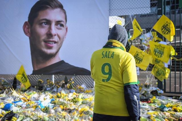 The former Nantes forward had tributes placed outside his home ground in France (Photo by LOIC VENANCE / AFP)
