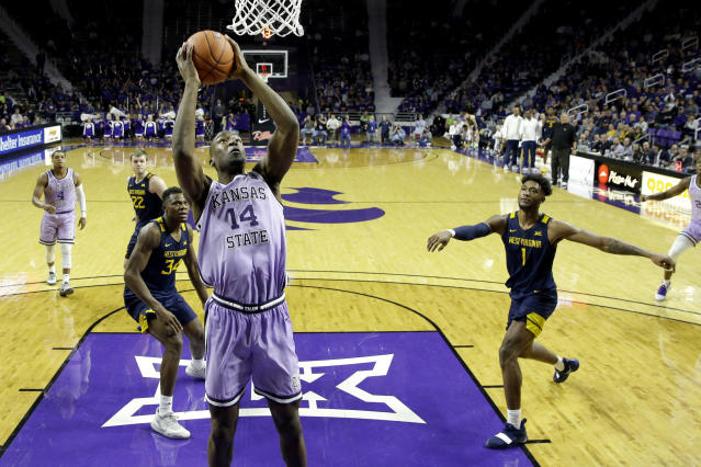 Kansas State's Makol Mawien (14) puts up a shot during the second half of an NCAA college basketball game against West Virginia Saturday, Jan. 18, 2020 in Lawrence, Kan. Kansas State won 84-68. (AP Photo/Charlie Riedel)