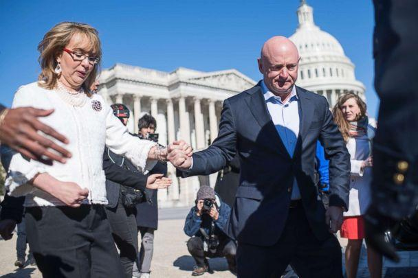 PHOTO: Mark Kelly, and his wife former Rep. Gabrielle Giffords, D-Ariz., are seen after a news conference with lawmakers at the House Triangle to call on Congress to act on gun safety legislation, March 23, 2018. (Tom Williams/CQ Roll Call/Getty Images)