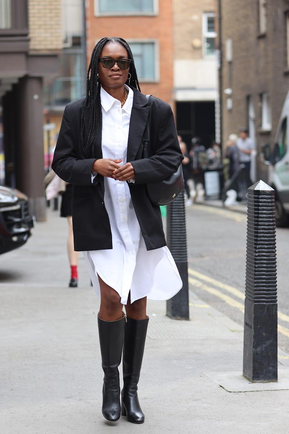 """A white dress shirt pairs with black knee-high boots and a loose fit blazer.<span class=""""copyright"""">Photo Courtesy of Neil Mockford/Getty Images.</span>"""
