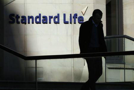 A worker leaves the Standard Life House in Edinburgh, Scotland