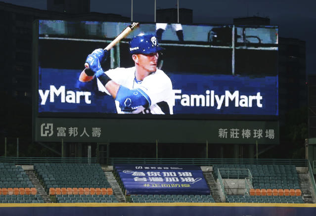 This photo shows a slogan reading ''Add Oil for You. Add Oil for Taiwan. Forward Epidemic Prevention'' on the Stadium stands with no audience at Xinzhuang Baseball Stadium in New Taipei City, Taiwan, Friday, April 24, 2020. ''Add oil'' means Chinese-language line of encouragement. Taiwan's five-team Chinese Professional Baseball League is barring spectators over concerns they would spread the deadly coronavirus, meaning games are played with plastic seats void of fans. (AP Photo/Chiang Ying-ying)