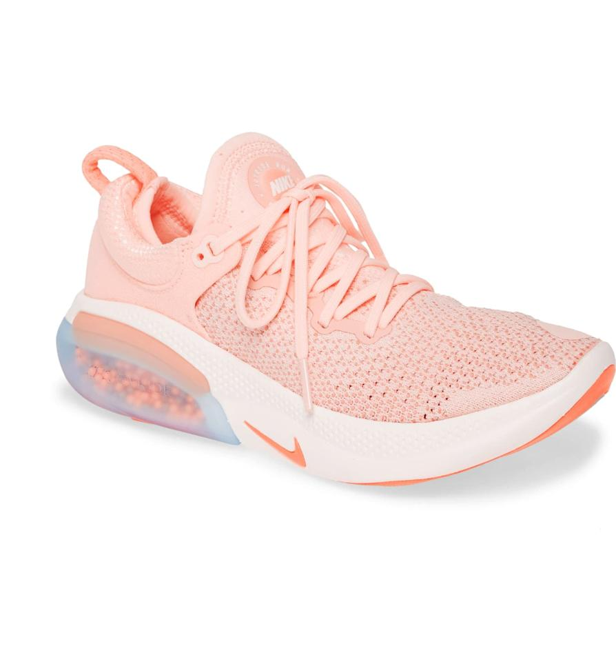 "<p>This <a href=""https://www.popsugar.com/buy/Nike-Joyride-Run-Flyknit-Running-Shoe-491906?p_name=Nike%20Joyride%20Run%20Flyknit%20Running%20Shoe&retailer=shop.nordstrom.com&pid=491906&price=180&evar1=fit%3Aus&evar9=45550264&evar98=https%3A%2F%2Fwww.popsugar.com%2Fphoto-gallery%2F45550264%2Fimage%2F45550367%2FNike-Joyride-Run-Flyknit-Running-Shoe&list1=nordstrom%2Csneakers%2Crunning%20shoes%2Cfitness%20gear%2Cfitness%20shopping&prop13=api&pdata=1"" rel=""nofollow"" data-shoppable-link=""1"" target=""_blank"" class=""ga-track"" data-ga-category=""Related"" data-ga-label=""https://shop.nordstrom.com/s/nike-joyride-run-flyknit-running-shoe-women/5178403?origin=category-personalizedsort&amp;breadcrumb=Home%2FBrands%2FNike%2FWomen%2FShoes&amp;color=sunset%2F%20orange%2F%20pink%20quartz"" data-ga-action=""In-Line Links"">Nike Joyride Run Flyknit Running Shoe</a> ($180) is made from a lightweight material that won't drag you down.</p>"